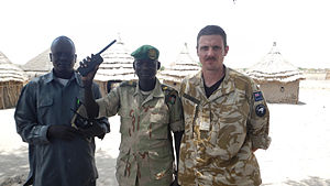 United Nations Mission in South Sudan - A New Zealand Army officer assigned to UNMISS with a member of the Sudan People's Liberation Army and a civilian in March 2012.
