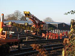 2014 Taunton track renewals - Colas crane 81612 laying panel on down main.JPG