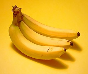 3 bananas on a yellow background