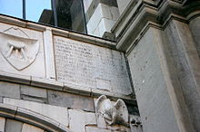 "A plaque on the Osii Loggia in Piazza Mercanti (""Merchant square"") in Milan, built in 1316 by Scoto da San Gimignano for Matteo I Visconti"