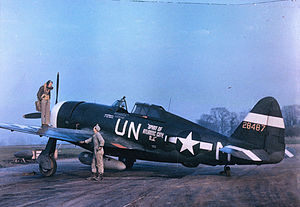 "RAF Halesworth -  Captain Walker ""Bud"" Mahurin of the 56th Fighter Group standing on the port wing of his P-47 Thunderbolt aircraft, conversing with its crew chief, Staff Sergeant John E. Barnes.The aircraft had been ""bought"" courtesy of war bonds purchased (to a value approximately equivalent to the cost of a fighter) by the citizens of Atlantic City, New Jersey. Consequently, the name painted on the aircraft was chosen by Atlantic City."