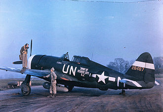 """RAF Halesworth -  Captain Walker """"Bud"""" Mahurin of the 56th Fighter Group standing on the port wing of his P-47 Thunderbolt aircraft, conversing with its crew chief, Staff Sergeant John E. Barnes.The aircraft had been """"bought"""" courtesy of war bonds purchased (to a value approximately equivalent to the cost of a fighter) by the citizens of Atlantic City, New Jersey. Consequently, the name painted on the aircraft was chosen by Atlantic City."""