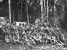A group of weary soldiers in a jungle scene