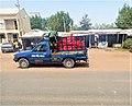 A Mini Truck supplying bottles of Soft drinks.jpg