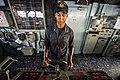 A Sailor mans the helm aboard USS Vella Gulf. (14221602680).jpg