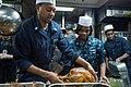 A Sailor serves a Thanksgiving meal. (15736999220).jpg