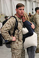 A U.S. Marine with Marine All-Weather Fighter Attack Squadron 224 hugs a loved one after a six-month deployment to the Western Pacific in Support of the Unit Deployment Program aboard Marine Corps Air Station 130322-M-EK666-001.jpg