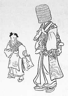 Un monaco Zen fuke (komus?) con il caratteristico copricapo mentre suona il flauto shakuhachi in una stampa del 1867.