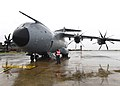 A contractor waits for the crew of a Turkish Airbus A400M Atlas to disembark.jpg