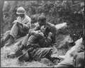 A grief stricken American infantryman whose buddy has been killed in action is comforted by another soldier. In the... - NARA - 531370.tif
