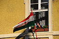 A woman setting up Hungary Budapest national flag at her window. Budapest, Hungary, Eastern Europe, 21 October 2012.jpg