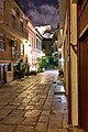Afroditis Street in Plaka at night. In the background the Acropolis.jpg