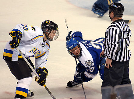 An official about to drop the puck during a faceoff. Air Force & Alaska - Fairbanks hockey faceoff.JPG
