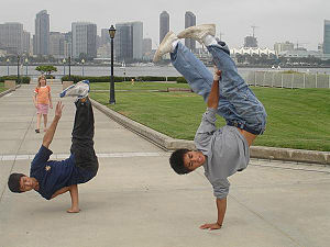 Freeze (b-boy move) - San Diego B-Boys demonstrate an airchair (left) and pike (right)