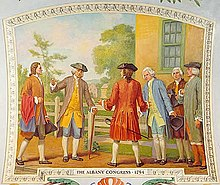 A painting shows men standing outside a yellow building; the men are dressed in revolutionary clothing with tri-pointed hats and powdered wigs.