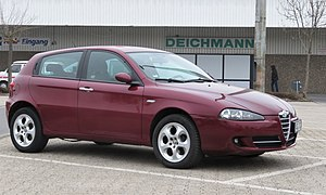 Alfa Romeo 147 (post facelift) outside shoe shop in Aachen.jpg