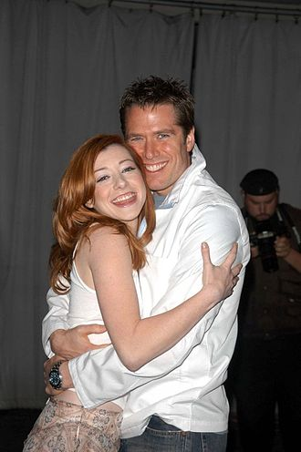 Alexis Denisof - Denisof with wife Alyson Hannigan, April 18, 2003