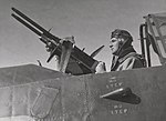 An observer at controls of Browning machine gun in a RAAF Vultee Vengeance.jpg