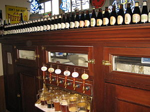 Bottles of beer line the top of the bar at Anc...