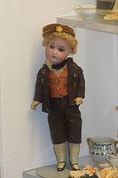 Antique German boy doll in traditional clothing (24866508783).jpg