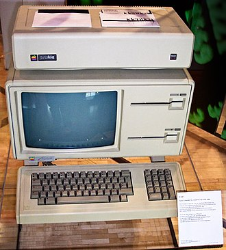 "Apple Lisa - Apple Lisa, with an Apple ProFile external hard disk sitting atop it. Note the dual 5.25-inch ""Twiggy"" floppy drives."