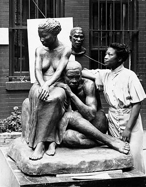Augusta Savage - Augusta Savage with one of her sculptures for the Federal Art Project (c. 1938)