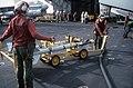 Aviation ordnancemen transport AIM-9 Sidewinder air-to-air missiles on a missile rack aboard the aircraft carrier USS AMERICA (CV 66) - DPLA - c0e3e1003dc10caa3bece9ae316ea1ad.jpeg