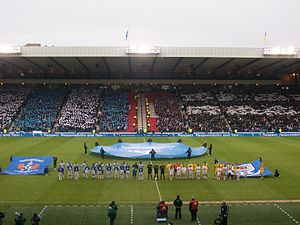 Ayrshire derby - Both sets of fans hold up card displays as the teams line up before the 2012 Scottish Communities League Cup Semi-Final.