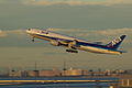 B777-200 ER take off in sunset (Tokyo international airport RWY 34R) (264809064).jpg