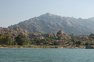 Beşparmak Mountains - Mount Latmus and the village of Kapıkırı among the ruins of Heracleia, with Lake Bafa in foreground. View is to the north.