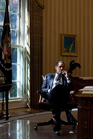 President Barack Obama talks by phone with Lon...