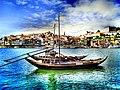 Barcos Rabelo no Rio Douro com a Ribeira ao fundo - panoramio.jpg