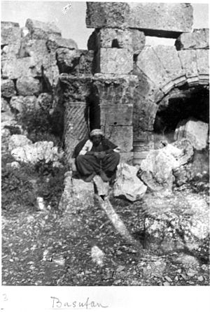 Dead Cities - Image: Basufan Church of St. Phocas Apse and arch of Prothesis Corinthian columns with spiral fluting and wind blown capital. Kurdish man seated in foreground