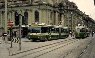 Trolleybuses in Bern - Trolleybus 62 and tram 624 in 1990, in the olive-green colour that was prominent in the SVB livery for many years prior to the 2000s