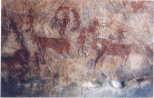 Horse - Bhimbetka rock painting showing man riding on horse, India
