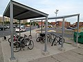 Bicycle shelter at Sullivan Square station, July 2015.JPG