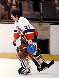 Billy Smith skating with the Islanders with his goaltender mask off.