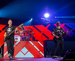 Blink-182 performing in 2016. From left to right: Mark Hoppus, Travis Barker, and Matt Skiba.