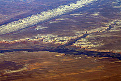 Bluff from the air, on the San Juan River, below Comb Ridge
