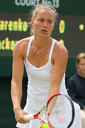Kateryna Bondarenko - Bondarenko about to serve at the 2015 Wimbledon Championships
