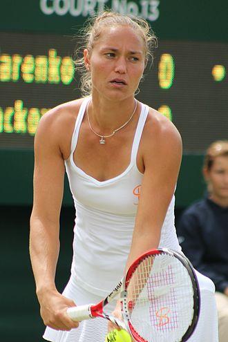 Kateryna Bondarenko - Bondarenko about to serve at the 2015 Wimbledon Championships