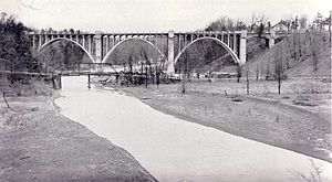 Bronte Creek - The Bronte Creek bridge in 1936, built as part of The Middle Road, now known as the Queen Elizabeth Way. The original iron truss bridge from the country lane is in the foreground.