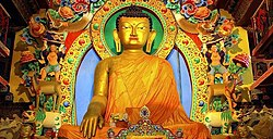 Buddhism is practiced by 13% of the population. Shown here is a statue of Buddha in Twang, Arunachal Pradesh.