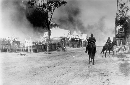 German soldiers on horseback in a burning village near Mogilev at the Dnieper. The Red Army has been driven out by German artillery fire. Bundesarchiv Bild 101I-137-1032-14A, Russland, brennendes Dorf, deutsche Kavallerie.jpg