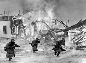 German occupation of Norway - German infantry attacking through a burning Norwegian village, April 1940.