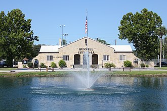 National Register of Historic Places listings in Flagler County, Florida - Image: Bunnell Coquina City Hall Full Front View with Lake Lucille & Fountain