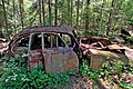 Car-wreck in wood near town Ryd in South of Sweden.jpg