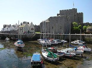 Castle Rushen seen across Castletown Harbour at low tide