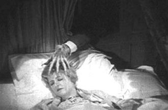 The Cat and the Canary (1927 film) - Annabelle West (Laura La Plante) is stalked in the night.