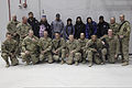Celebrities with the 2013 USO Chairman's Holiday Tour pose for a group photo at Bagram Airfield in Parwan province, Afghanistan, Dec. 9, 2013 131209-A-WS742-169.jpg